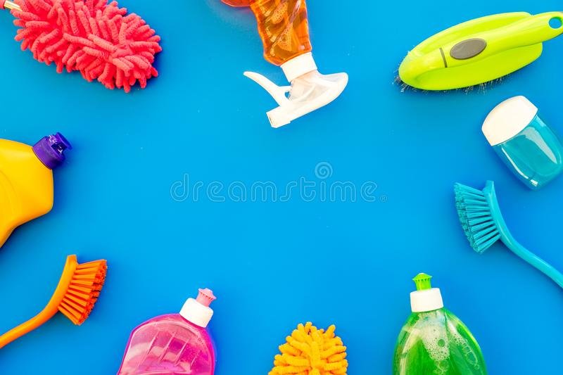 Housekeeping set. Detergents, soap, cleaners and brush for housecleaning on blue background top view mock-up stock images