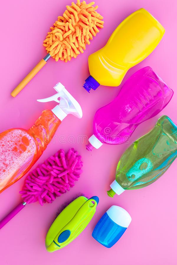 Housekeeping set. Detergents, soap, cleaners and brush for housecleaning on pink background top view mock-up royalty free stock image