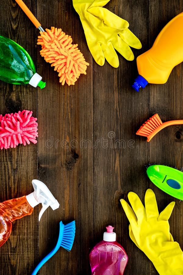 Housekeeping set. Detergents, soap, cleaners and brush for housecleaning on wooden background top view mock-up stock image