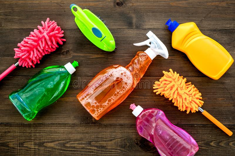 Housekeeping set. Detergents, soap, cleaners and brush for housecleaning on wooden background top view mock-up stock photography