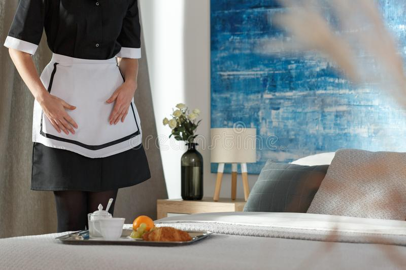 Housemaid in bedroom royalty free stock photos