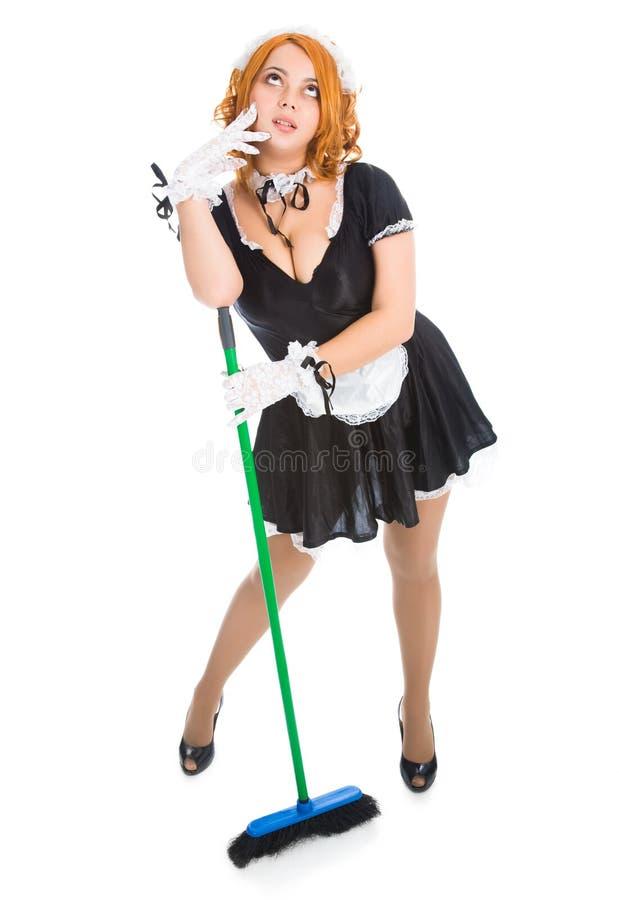 Housemaid tired novo com vassoura foto de stock