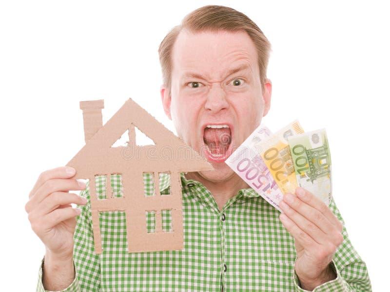 Houseowner frustrant avec l'argent image libre de droits