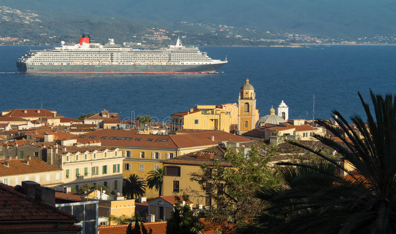 The houses of Ajaccio city, Corsica island, France. The houses of Ajaccio city, the capital of South Corsica island and giant cruise ship in the bakgroung stock photography