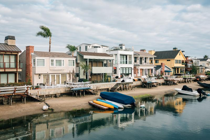 Houses along a canal on Balboa Island, in Newport Beach, Orange County, California.  stock photography