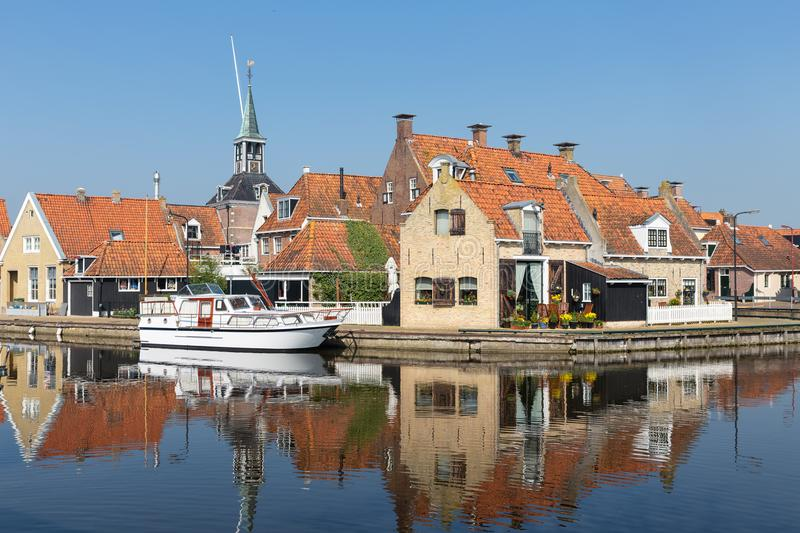 Houses along a canal in Makkum, an old Dutch village stock photography