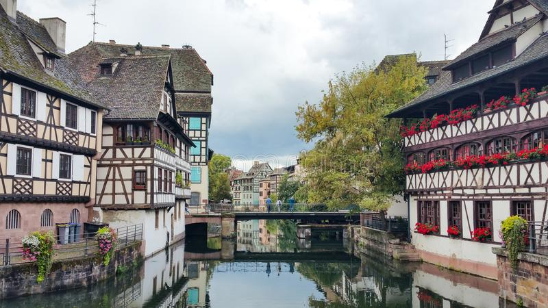 Houses along Ill river in Strasbourg, Petite France quarter on a sunny day stock photos
