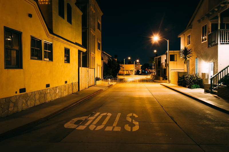 Houses along a street at night, in Newport Beach royalty free stock images