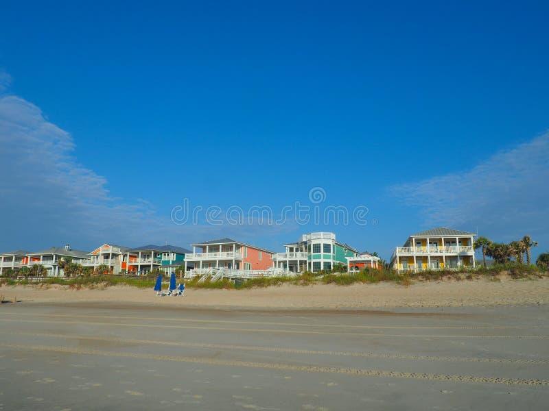 Houses on the Atlantic Coastline at Carolina Beach. A row of colorful houses along the Atlantic coastline shore in Carolina Beach, North Carolina royalty free stock photography