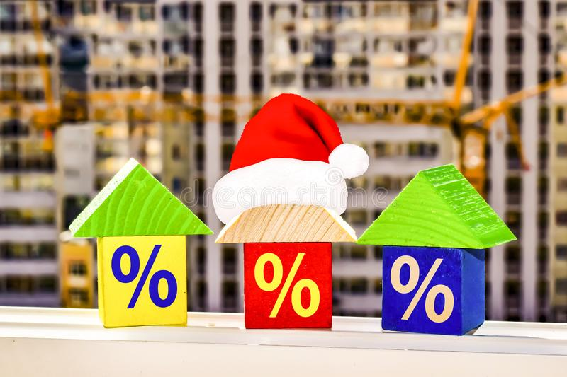 The houses on the background of building a new home . Christmas sale real estate.  royalty free stock photos