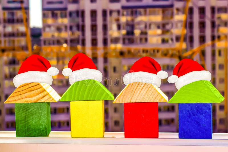 The houses on the background of building a new home . Christmas sale real estate . The houses on the background of building a new home . Christmas sale real stock images