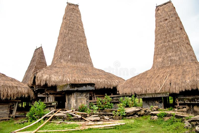 Kodi, Sumba Island, Nusa Tenggara, typical houses with tall roofs. royalty free stock photos