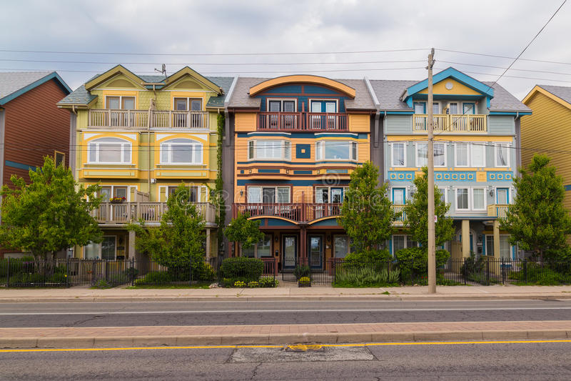 Houses in The Beaches Toronto. TORONTO, CANADA - 25TH JUNE 2015: Different colored houses in The Beaches area of Toronto during the day royalty free stock photo