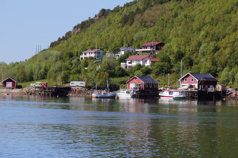 Houses and boats of Meloey. Typical fishermen's and farmers small settlement , Norwegian polar circle royalty free stock image