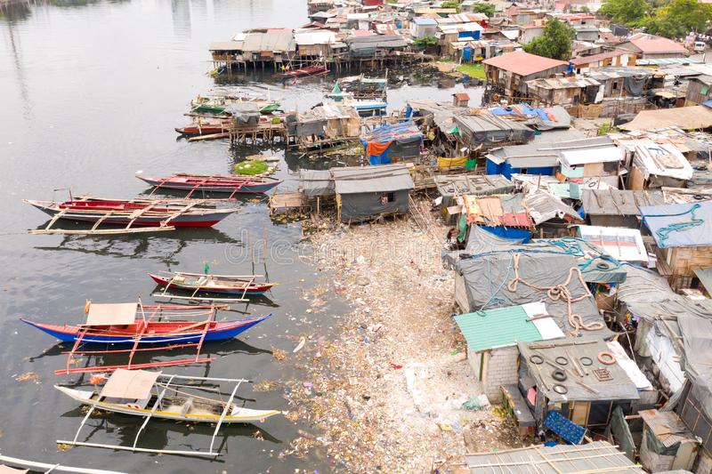 Slums and rubbish in Manila. Houses and boats of the poor inhabitants of Manila. Dwelling poor in the Philippines. Houses and boats of the poor inhabitants of royalty free stock images