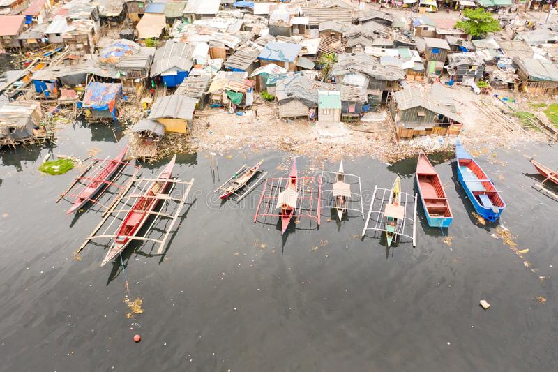 Slums and rubbish in Manila. Houses and boats of the poor inhabitants of Manila. Dwelling poor in the Philippines. Houses and boats of the poor inhabitants of stock images