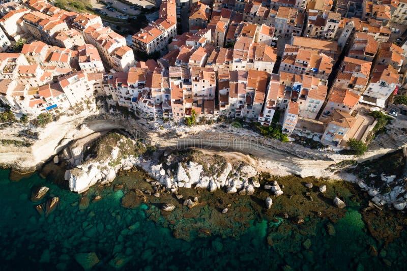 Houses of Bonifacio on a limestone cliff, Corsica. Houses on top of a limestone cliff high above the Tyrrhenian Sea, Bonifacio, Corsica island, France royalty free stock photography