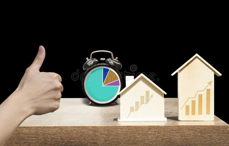 Investing in properties that have good returns in a short period of time. Houses, buildings and clocks in the picture have a graph line up. Represents investment royalty free stock photo