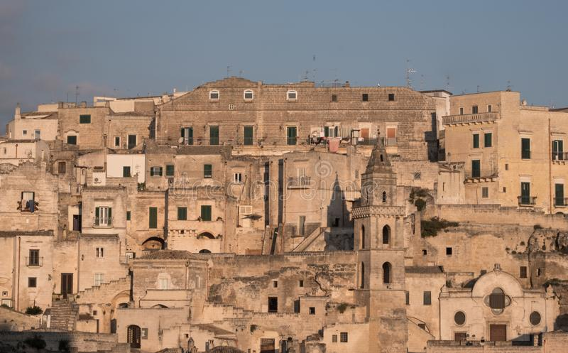 Houses built into the rock in the cave city of Matera, Sassi di Matera, Basilicata Italy. Matera has been designated European Capital of Culture for 2019 stock images