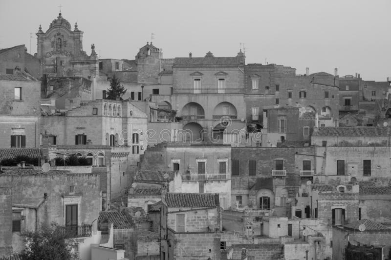 Houses built into the rock in the cave city of Matera, Sassi di Matera, Basilicata Italy. Matera has been designated European Capital of Culture for 2019 royalty free stock images