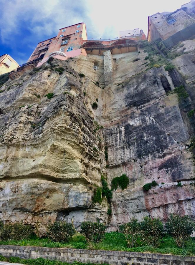Houses built on the sheer cliffs of the city of Tropea in Italy stock photography