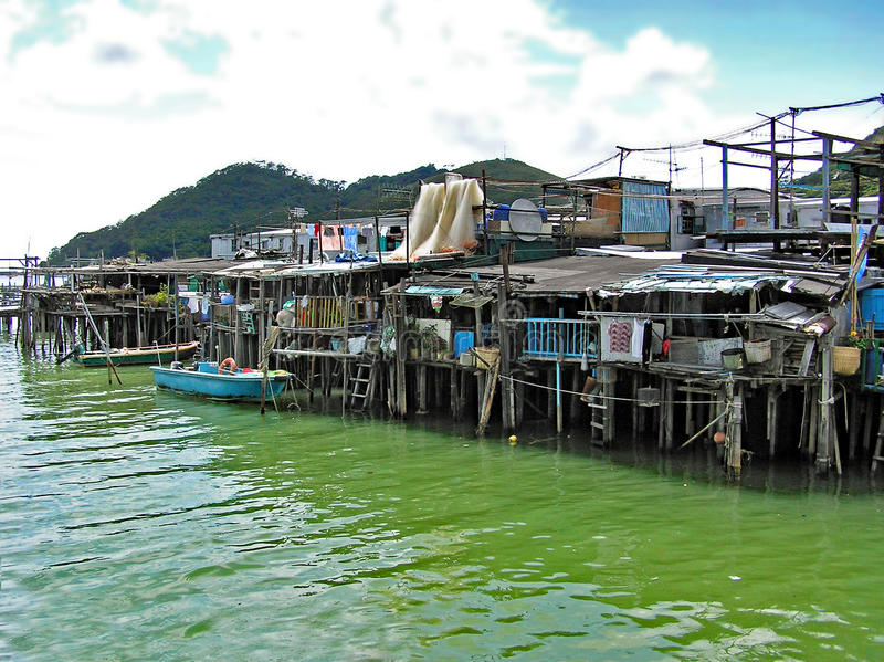Houses built on stilts over the water in the fishing village Tai O on Lantau Island in Hong Kong royalty free stock photos