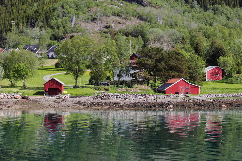 Houses and cabins of Meloey. White house and red cabins of an island Norwegian polar circle stock photos