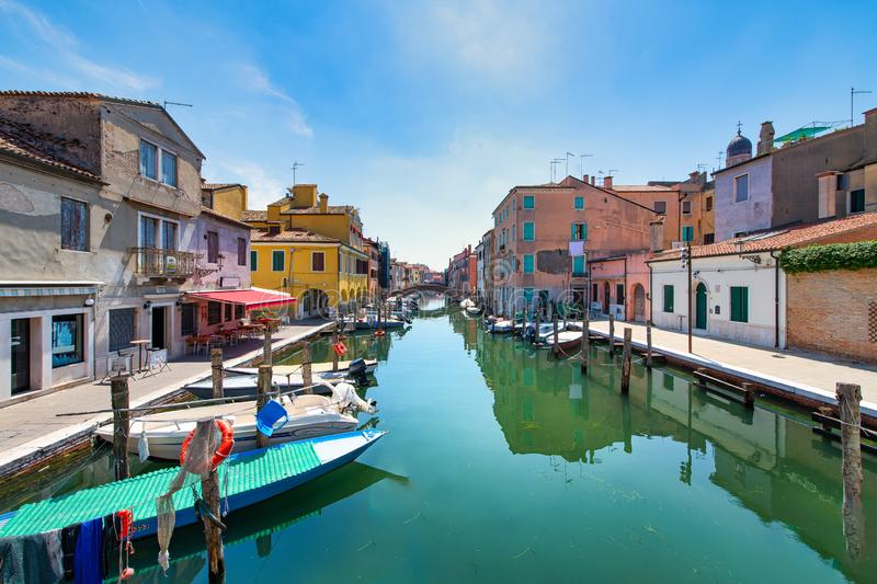 Houses on a canal in Chioggia in Italy.  royalty free stock photography