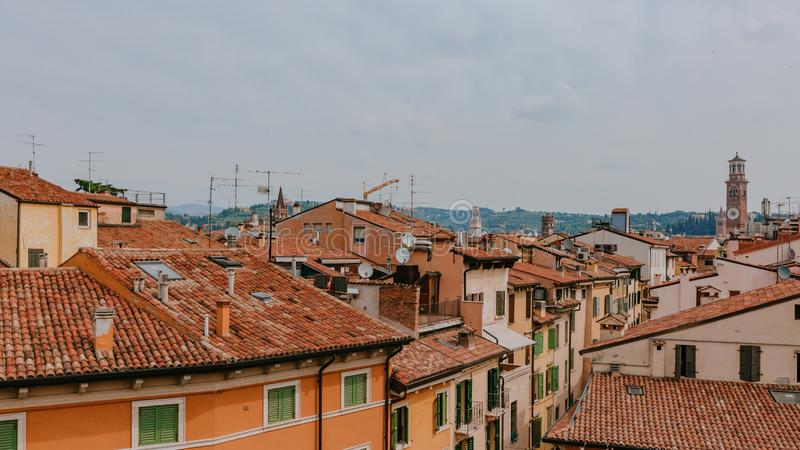 Houses and cityscape of Verona, Italy, with Lamberti Tower, Verona`s tallest medieval tower. View of houses and the city of Verona, Italy, with Lamberti Tower royalty free stock images