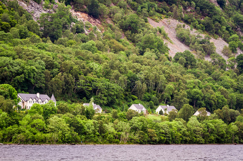 Houses on the cliff in the mountains royalty free stock photography