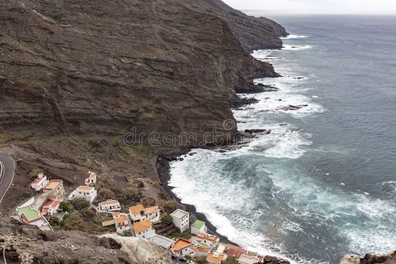 Houses and cliff near the ocean at Alojera village. La Gomera. Canary Islands. Spain royalty free stock photo