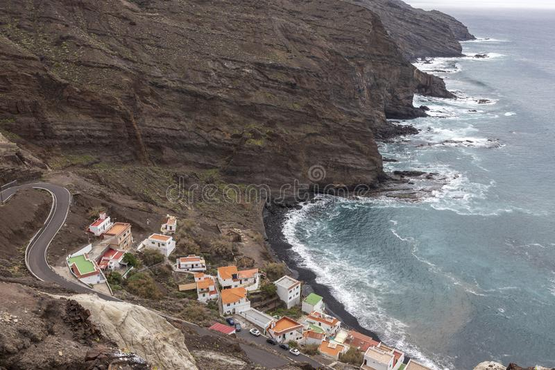 Houses and cliff near the ocean at Alojera village. La Gomera. Canary Islands. Spain royalty free stock photos