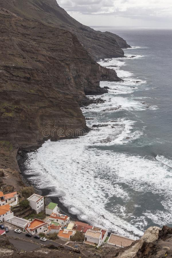 Houses and cliff near the ocean at Alojera village. La Gomera. Canary Islands. Spain royalty free stock image