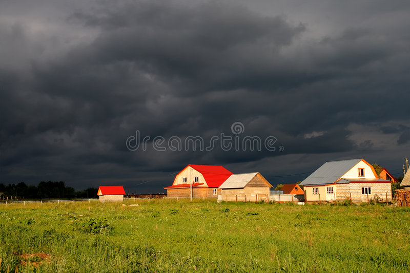 Houses and clouds royalty free stock image