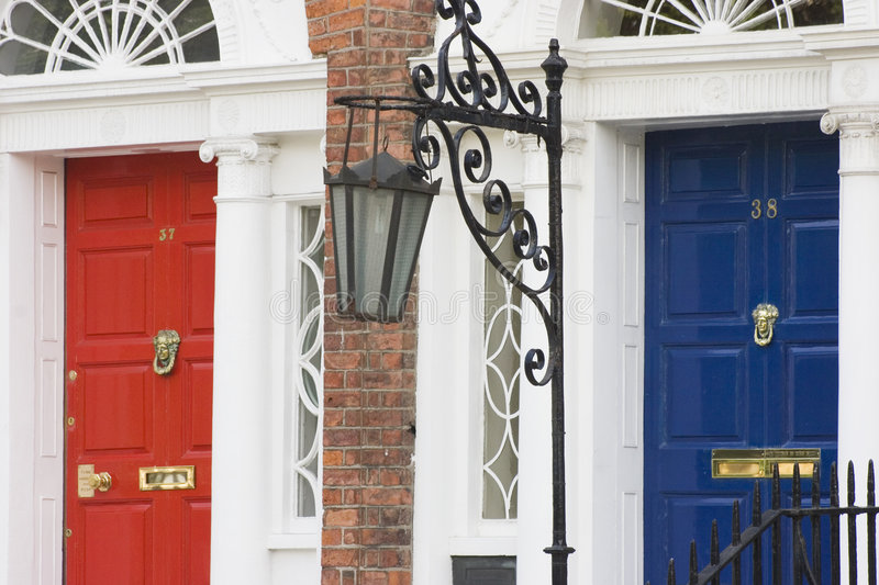 Houses coloured doors. With georgian style doors and elegant light - Dublin stock images