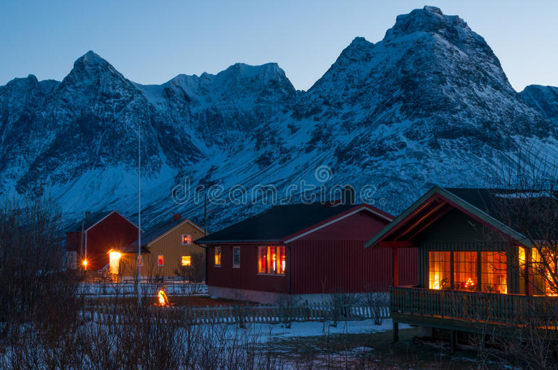 Houses with decoration lights near Svensby village in Norway during Polar Night.  royalty free stock image