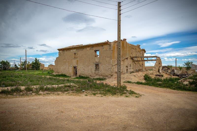 Town stuck in `La España Vaciada`. Houses demolished at sunset. Otero de Sariegos, Zamora royalty free stock photo