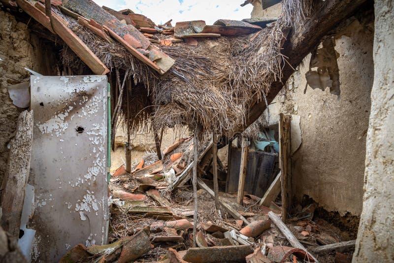 Town stuck in `La España Vaciada`. Houses demolished at sunset. Otero de Sariegos, Zamora royalty free stock photos