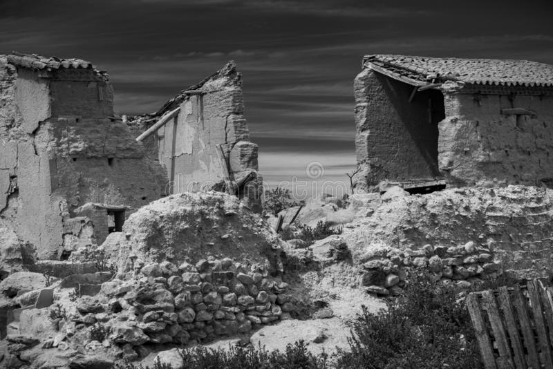 Town stuck in `La Espana Vaciada`. Houses demolished at sunset. Otero de Sariegos, Zamora royalty free stock photo