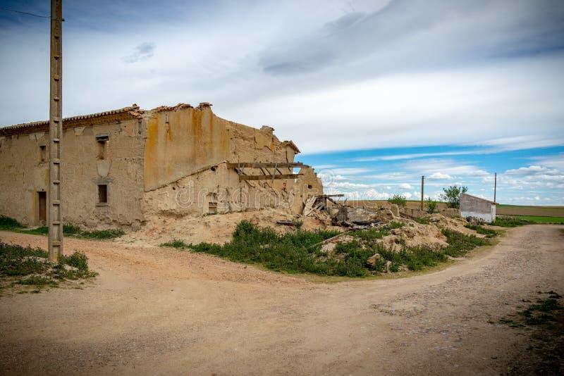 Town stuck in `La Espana Vaciada`. Houses demolished at sunset. Otero de Sariegos, Zamora stock photography