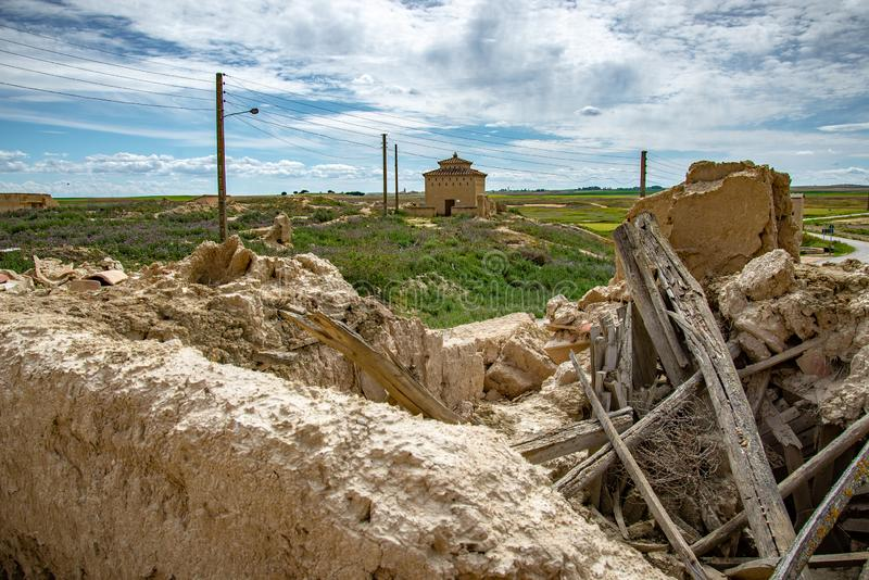 Town stuck in `La Espana Vaciada`. Houses demolished at sunset. Otero de Sariegos, Zamora stock images