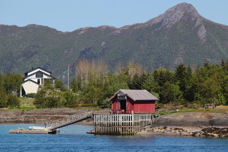 Houses and docks of Meloey. Typical fishermen's and farmers small settlement , Norwegian polar circle stock image