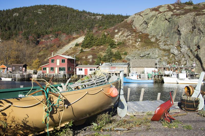 Boats on shores of historic Quidi Vidi Village, St. Johns, Newfoundland, Canada. Houses with fishing boats on waterfront of historic Quidi Vidi Village royalty free stock photos