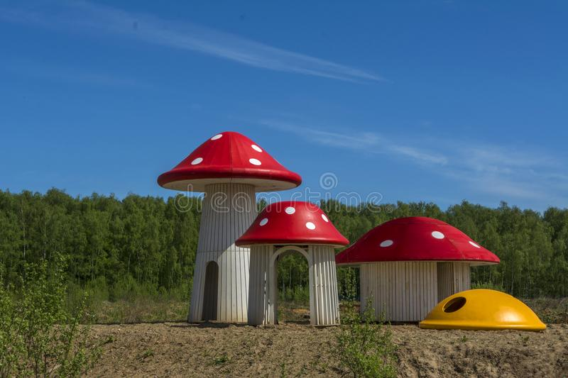 Houses in the form Of mushrooms fly agaric summer forest glade. stock photos