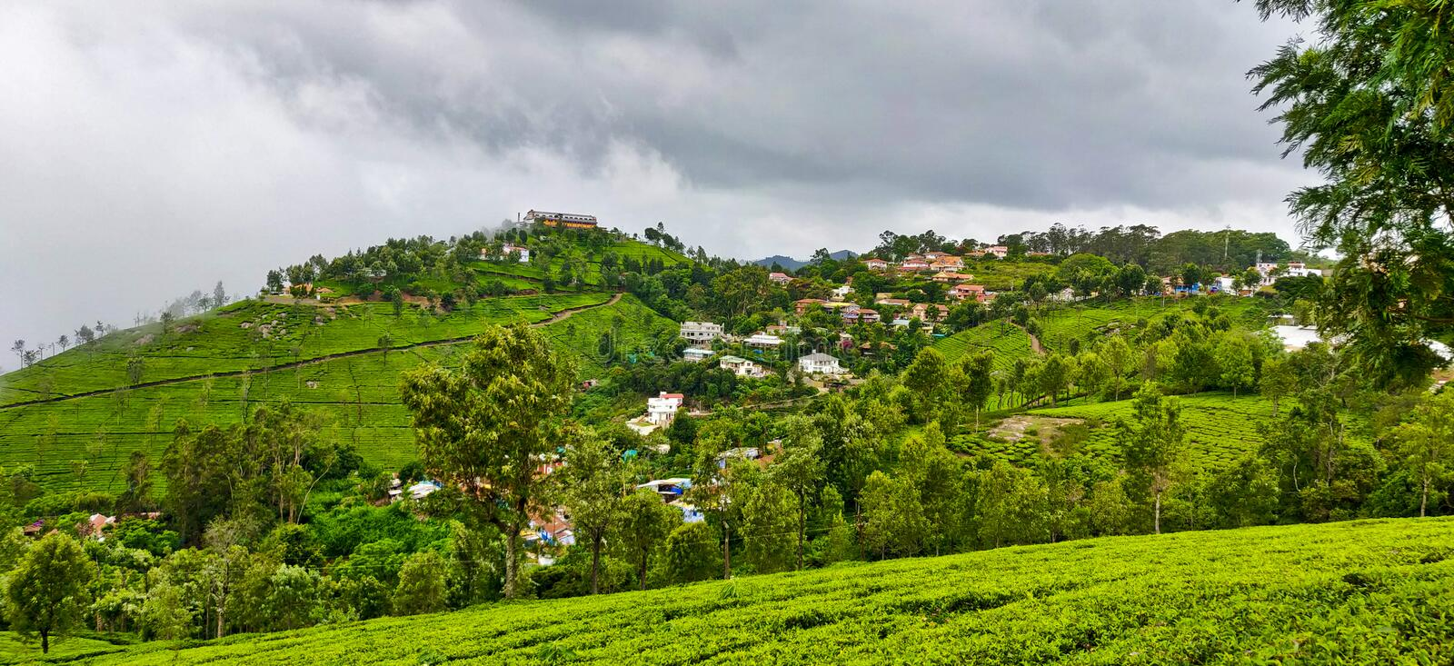 Houses on the hills of Coonoor under the rainy clouds of monsoon stock photography