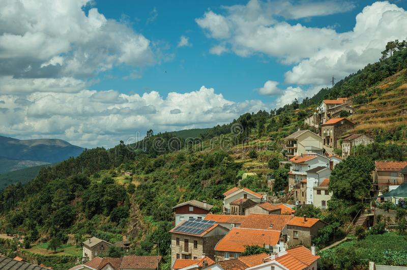 Houses on the hilly landscape covered by terraced fields stock photography