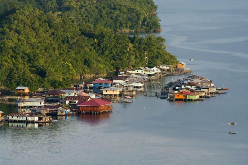 Houses on an island on the lake Sentani. New Guinea royalty free stock photos