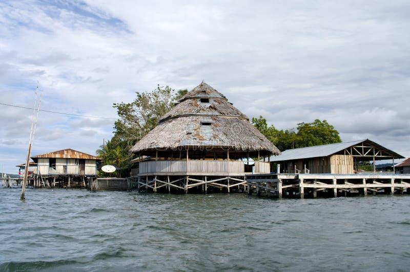 Houses on an island on the lake Sentani. New Guinea royalty free stock photography