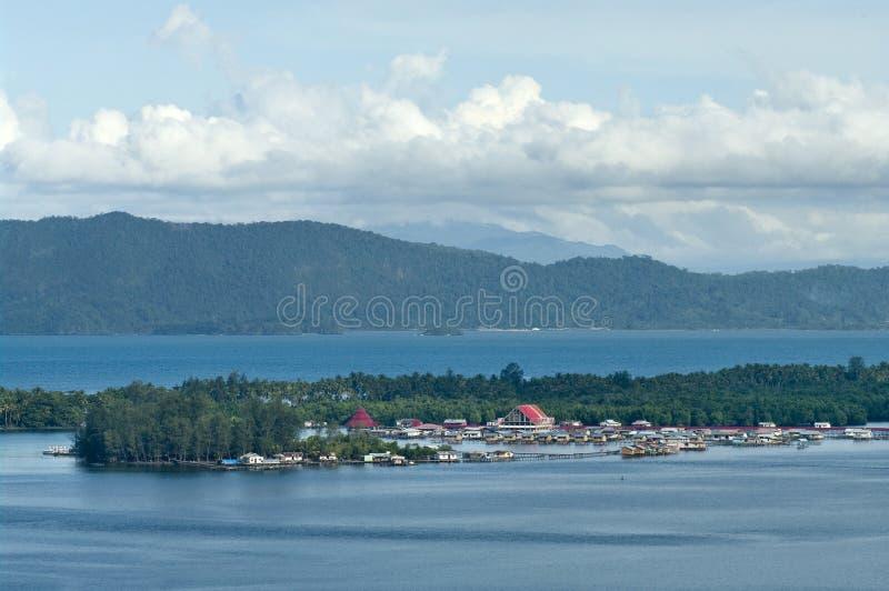 Houses on an island on the lake Sentani. New Guinea royalty free stock photo