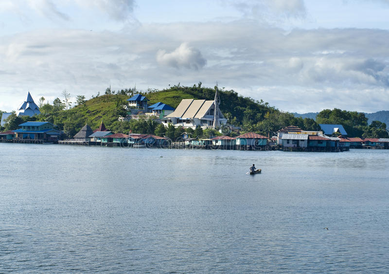 Houses on an island on the lake Sentani. New Guinea stock photography